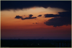 Черные тучи на закате дня. Фото закатов